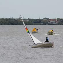 Boat with rainbow sail on the water