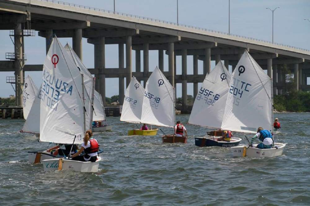 Many Youth Sailors with bridge in background