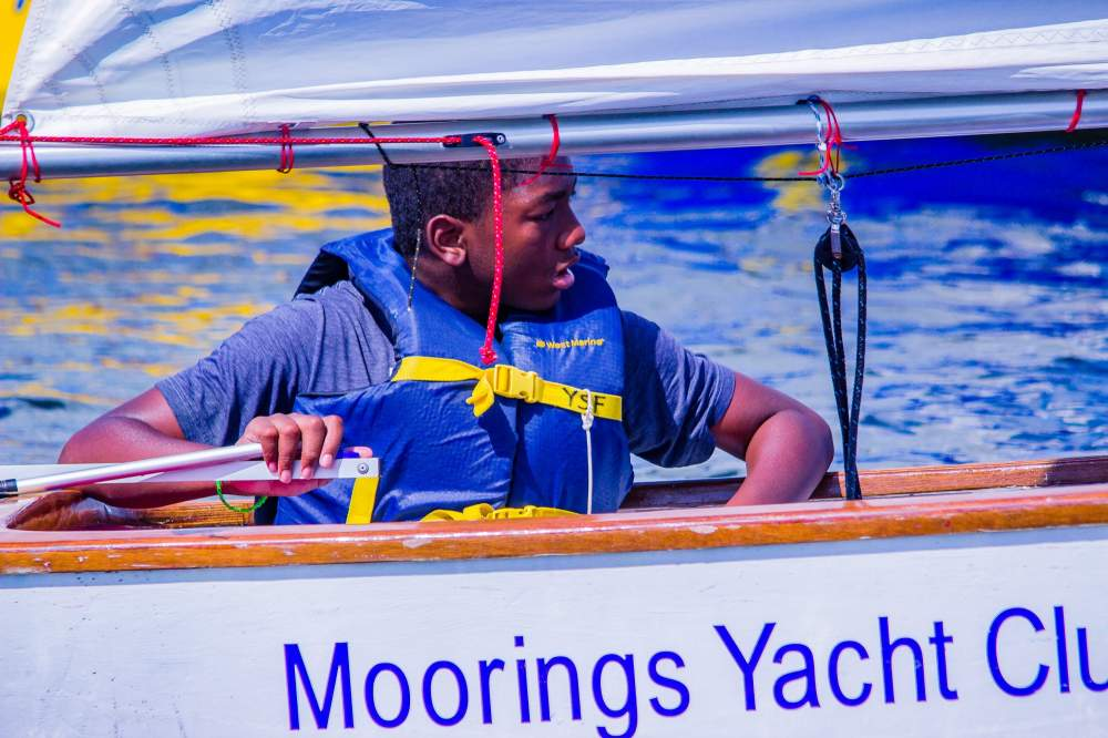 Young sailor in Moorings boat