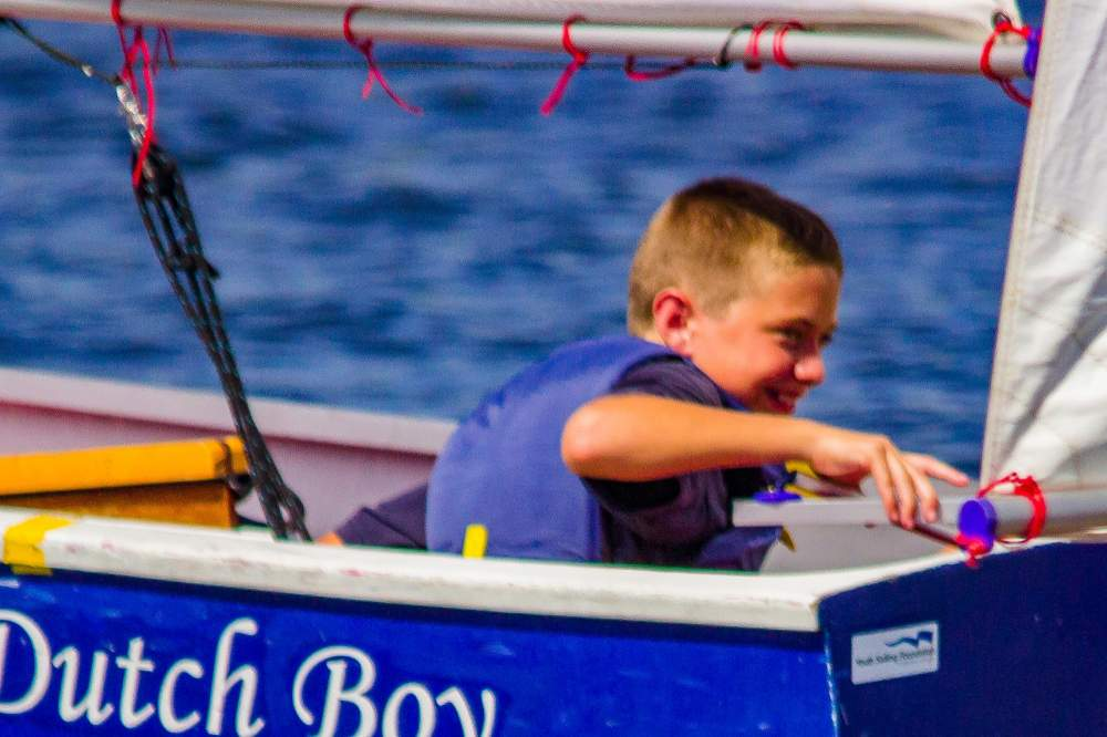 Young sailor in Dutch Boy boat