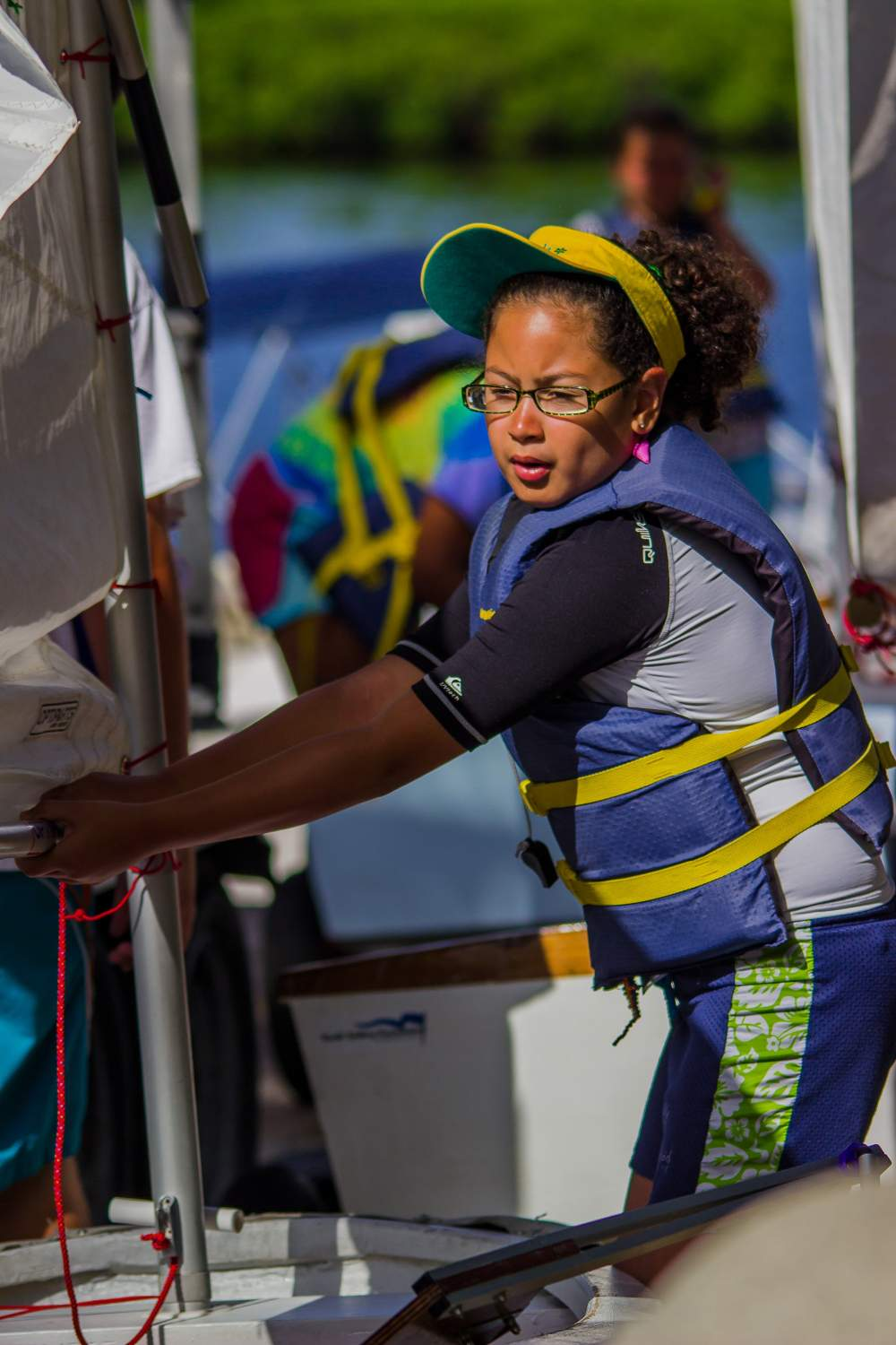 Youth Sailor working on her boat