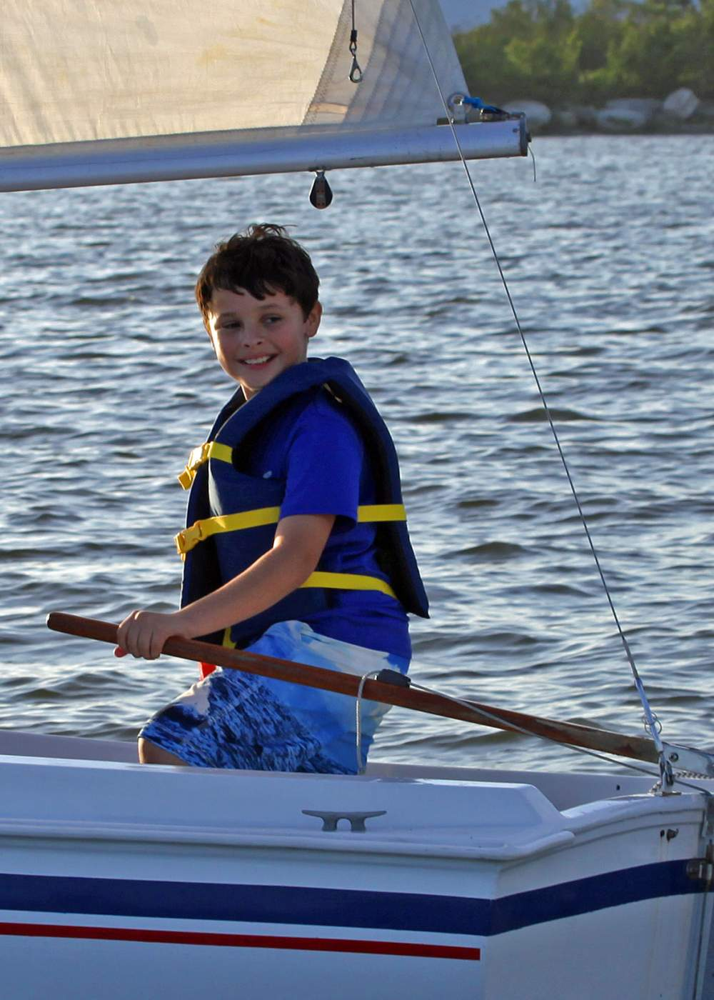 Young boy smiling while sailing